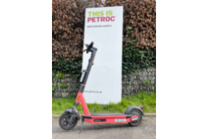 e-scooter in front of Petroc sign E-scooter trial takes off in Barnstaple